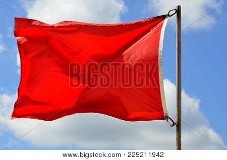 Lifeguard station red warning flag on the ocean beach