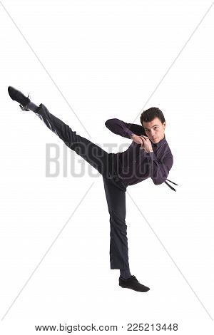 High-kicking in a business suit isolated on white background for any purpose