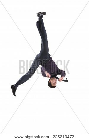 Flip upside down in a suit and tie isolated on white background  for any purpose