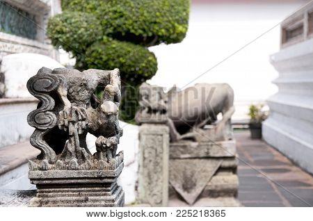 Bangkok, Thailand, territory of the temple Wat Arun Ratchawararam Ratchawaramahawihan or Wat Arun is a Buddhist temple. Fragment of Thai sculpture.