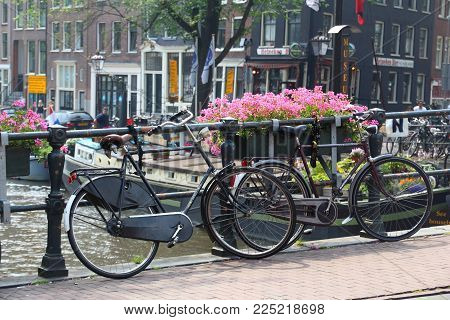 Amsterdam, Netherlands - July 7, 2017: Bicycles Parked On A Canal Bridge In Amsterdam, Netherlands.