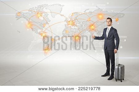 Businessman in dark suit hitchhike to business trip in a front of a map with destination