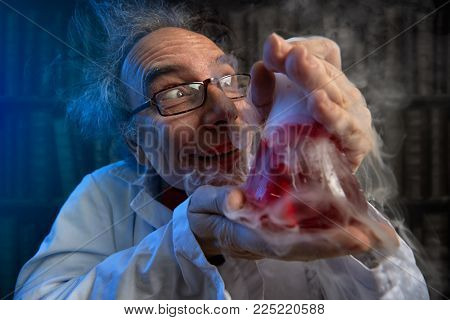 deranged scientist obsessed looking at his  experiments