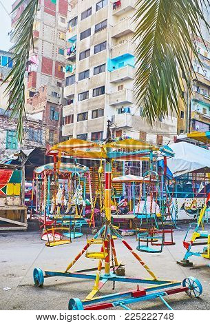 The Small Retro Luna Park In Residential District Of Alexandria Offers The Vintage Chair Swing Ride