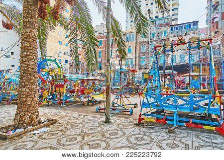 The Street Next To Abu Al-abbas Al-mursi Mosque Is Occupied With Retro Luna Park, Full Of Vintage Sw