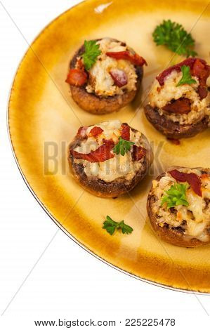 Stuffed Mushrooms with Bacon, Cheese and Breadcrumbs Isolated on White Background. Selective focus.