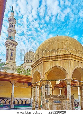 The old mosques of Alexandria - minaret and dome of Abu al-Abbas al-Mursi mosque and ablution fountain of Imam Al Busiri mosque, neighboring in the Mosque square, Egypt.