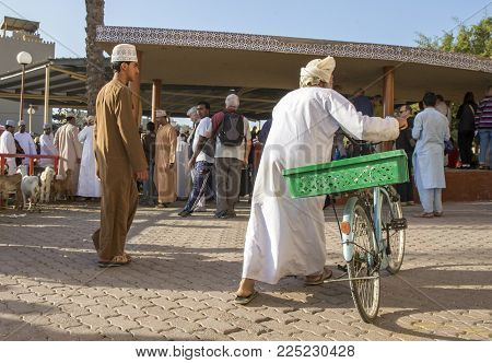 Nizwa, Oman, Febrary 2nd, 2018: Omani People At A Traditional Goat Auction That Happens Every Friday
