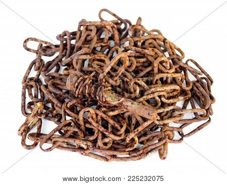 rusty screw lying on a pile of rusty chain Isolated