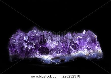 Natural Druse of amethyst on a black background front view
