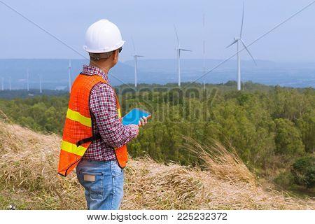 Male Architect Engineer Or Businessman Wear Hardhat Survey Wind Turbine Power Generator Field Site P