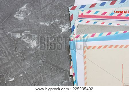 old envelopes and cards on gray concrete back
