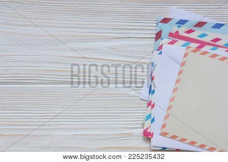 few old envelopes and cards on wooden back