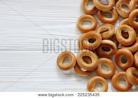 russian small dry bagels on wooden panel
