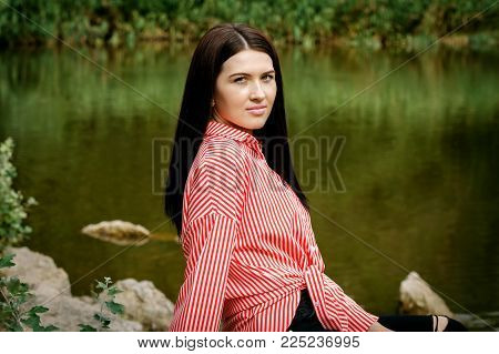 Beautiful woman in dress at river background closeup portrait. Female, face.