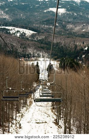 uphill cableway on the mountain slope in the forest