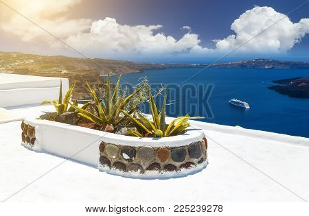 view of beautiful sea and caldera with luxury roof terrace, typical white architecture of Santorini island, Greece