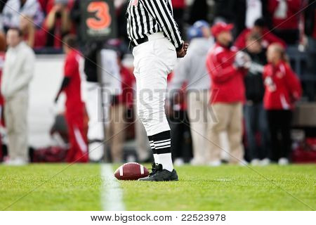 Ball resting on the Yardline at a Football Game