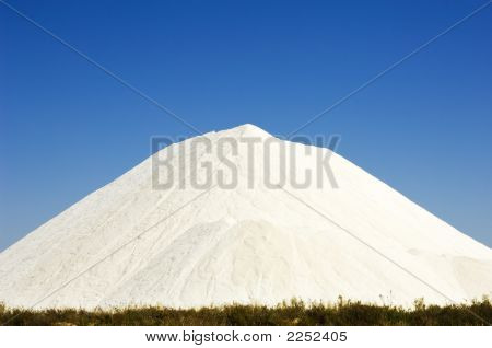 Heap of sea salt in a marsh Algarve Portugal poster