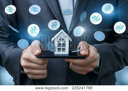 Layout of the house in the phone and fly interest. The concept of discounts on real estate.