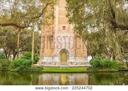The Singing Tower with its ornate brass door in Lake Wales, Florida. Bok Tower Gardens  is a National Historic Landmark  and a bird sanctuary located north of Lake Wales.