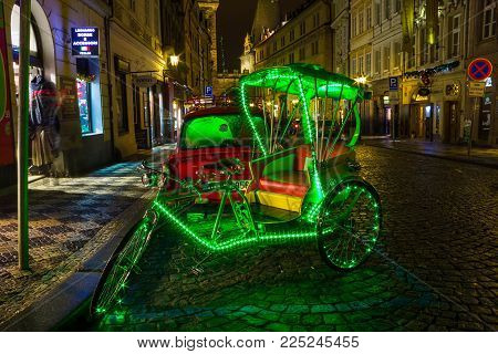 Prague, Czech Republic - December 31, 2017: Bicycle rickshaws for an evening stroll around Prague. Prague is the capital and largest city of the Czech Republic on December 31, 2017