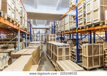 Logistic and distribution warehouse. Empty warehouse full of cargo. Cardboard boxes. Rows of shelves with paper boxes. Commercion concept