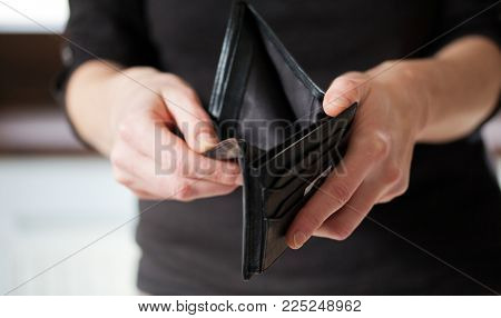 hand holding empty wallet