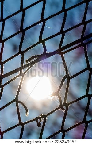 hole in a net and sun