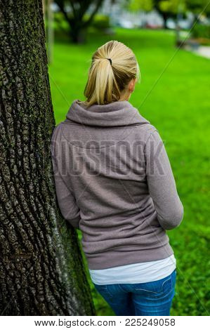 pensive young woman from behind