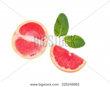 Grapefruit isolated, grapefruits.Sliced grapefruit with a leaves isolated on white background. Top view.
