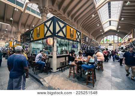 SAO PAULO, BRAZIL - FEBRUARY 02: Wide angle picture of people eating local food at Mercadao, market place located in Sao Paulo, Brazil