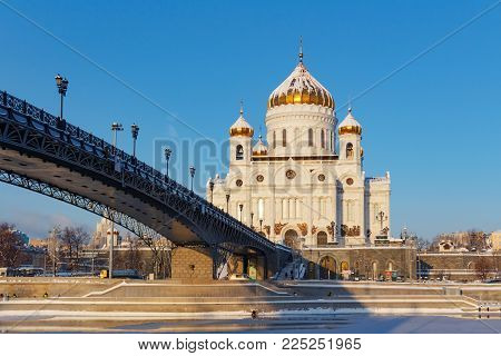 Moscow, Russia - February 01, 2018: Cathedral of Christ the Saviour on Patriarshiy Bridge background against the blue sky at sunny winter morning