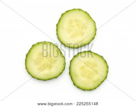 European cucumber three slices top view (burpless, seedless, hothouse, gourmet, greenhouse, English) isolated on white background