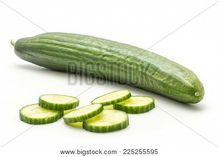 One European cucumber with six slices (burpless, seedless, hothouse, gourmet, greenhouse or English) isolated on white background