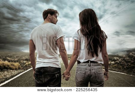 Conceptual photo of a young couple over an empty road