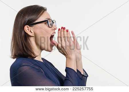 Woman shouting, screaming portrait in profile, white background
