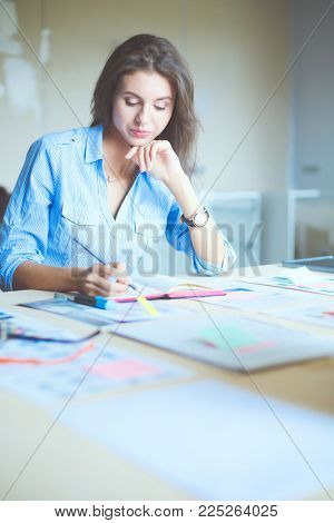 Young woman sitting at office table . Young woman.