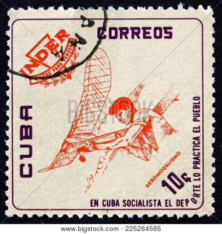 Cuba - Circa 1962: A Stamp Printed In Cuba Shows Model-plane Flying, National Sports Institute Emble