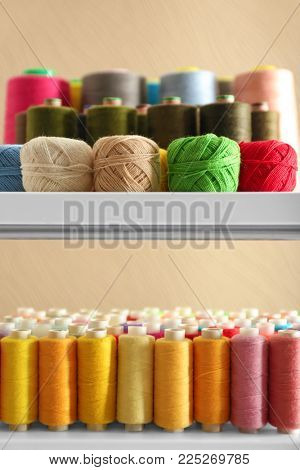 Set of color sewing threads and crocheting clews on shelves