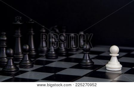 Black chess figures on board. Black chess figures row on checkered board. Chess figurine order. Black chess set in order for game start. Checkmate game banner template. Intellectual sport. Tactic game