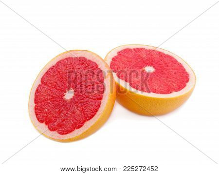Two Ripe half of pink grapefruit citrus fruit isolated on white background. Fresh juicy grapefruit, isolated on a white background, close-up.