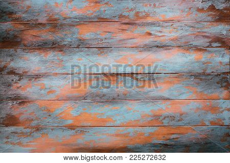 Wooden background with peeling paint, top view