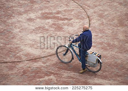 Leiden / The Netherlands - October 8th 2017 A Old Caucasian White Senior Male Sitting On His Bicycle