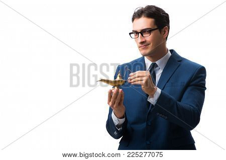 Businessman with magic lamp isolated on white
