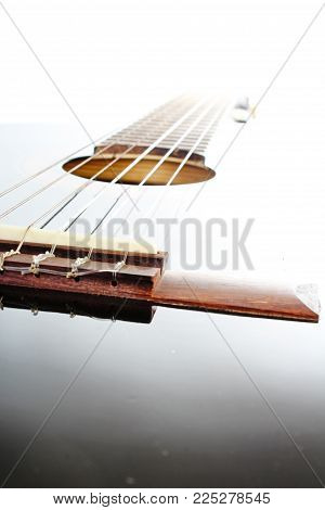 Guitar artsy POV background. Music illustration. Black and white guitar closeup. Photo.