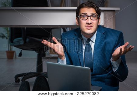 Businessman working overtime long hours late in office
