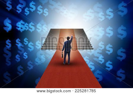 Young businessman climbing stairs and red carpet