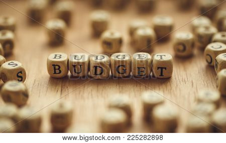 Word BUDGET on wooden cubes, selective focus. Business economy budgeting and planing concept