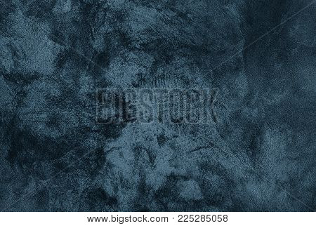 Abstract Grunge Decorative Dark Blue Grey stucco Wall Background. Gloomy Rough Smear Texture. Web Banner or Wallpaper With Copy Space For Design